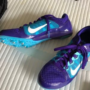 Nike tracks shoes, brand new in bag with spikes.
